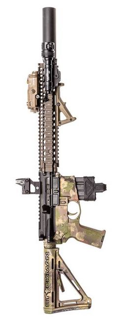 Centurion Arms barrel, Trijicon, Inc. optic, SureFire, LLC light, and lots of Magpul Industries Corp.. The rail is Daniel Defense. Photo by Stickman.