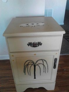 Freebee nightstand. Painted creamy coffee chaulk paint. Draw and painted sheep and tree. Coat of finishing wax and buff.
