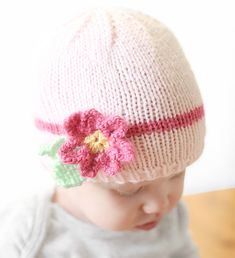 Our All Things You Baby Acrylic yarn is super soft and perfect for this easy baby hat knitting pattern. Decorate your hat with a delicate knitted flower.