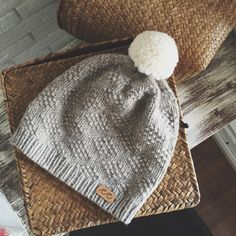 Handknitted hat with pompom