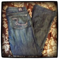 Rock & Republic ROTH Flare Leg Jeans in TURMOIL Rock & Republic ROTH Flare Leg Jeans in TURMOIL (Pink Blue). 32 width.  Was professionally tailored to inseam of 30 inches.  Immaculate condition. Rock & Republic Jeans Flare & Wide Leg