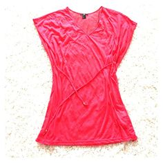 Pink Swim cover up Adorable swim cover up for trips to the beach or pool. This is a see thru material. Never worn! It's a size XS but fits like a small. Very loose fitting. H&M Swim Coverups