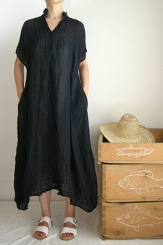 Daniela Gregis dress with sleeve. This looks awesomely cool and comfy for hot weather. Would be a good beach cover up.