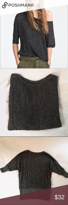 Zara Black Metallic Knit Black ribbed, half-sleeve sweater from Zara. Rainbow metallic jazzes up this Italian yarn classic. Round neck, light weight, cinched in waist and sleeve hems. Brand new, perfect condition, all tags still attached. Zara Sweaters Crew & Scoop Necks