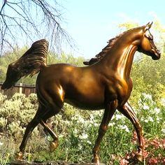 Golden color bronze sculpture of Arabian horse