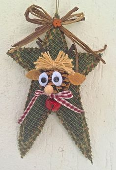 Natale - stella in tessuto con pigna-renna