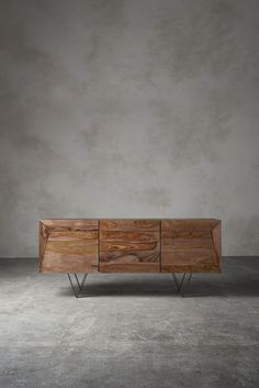 Stunning sideboard in rosewood and iron. Beautiful concrete walls are definitely…