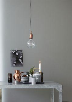 Helle Grautöne und ein bisschen Kupfer für die perfekte Balance zwischen cosy und modern.