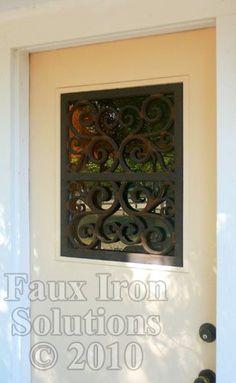 Faux iron window insert