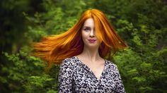 Redhead spin the world by Andrei Grososiu on 500px