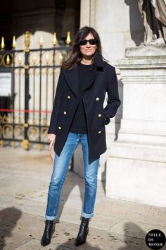 A nicely put together combination of a navy blue coat and blue ripped jeans will set you apart effortlessly. For the maximum chicness opt for a pair of black leather ankle boots.  Shop this look for $76:  http://lookastic.com/women/looks/sunglasses-crew-neck-sweater-coat-jeans-ankle-boots/6051  — Black Sunglasses  — Black Crew-neck Sweater  — Navy Coat  — Blue Ripped Jeans  — Black Leather Ankle Boots