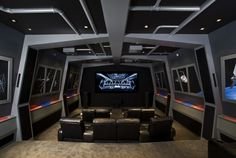 contemporary media room by Orren Pickell Building Group - looks like a real shuttle