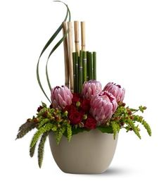 Hypericum Berry, hanging amaranthus, Millet, River Cane, Lily Grass, Spray Roses, Pink Mink Protea