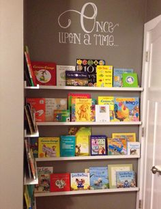 book nook in another wise unused space - RIBBA picture ledge from IKEA + Etsy wall decal = Custom kids library.