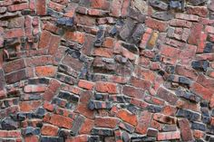 Red brown and black old klinker brick wall Stock Photo