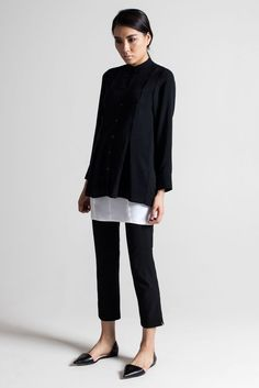 I love the roomy sweater that still hangs straight with the long-tailed shirt beneath it. I'd wear it with looser cropped pants.