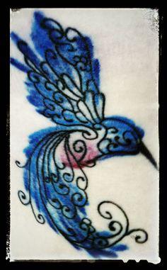 Hummingbird watercolor tattoo.