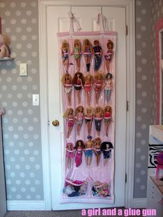 Barbie organizer - i love these back of the door organizers. Have 1 in bathroom for all our stuff and 1 on girls door...great idea for little toys too!