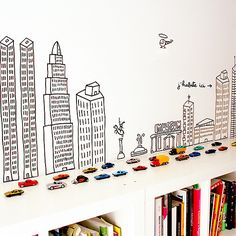 Bookshelf Ideas for Kids' Rooms // bookshelf city playscape.....place short shelving unit on floor at foot of bed build a wall behind unit and paint city scape on it