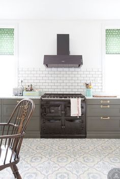 A Swedish style kitchen.  Love the floor tiles, so pretty!