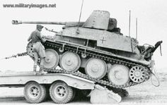 A captured Marder 3 tank destroyer being taken off the battlefield by a American recovery team serving in North Africa