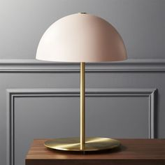 Shop Hanna Pink Table Lamp.   Casting a classic dome shape in new light, this pink table lamp is an exclusive design by Mermelada Estudio.  Opaque shade attaches to iron pole with a single decorative screw.  Learn about  on our blog.  CB2 exclusive.