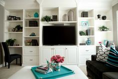 I want walls full of shelves. apparently I love storage. (Plus I like the style touches here)