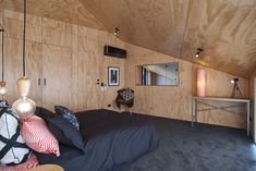 Master bedroom with ensuite and cavity slider to living room. Views to the Remarkables while lying in bed.