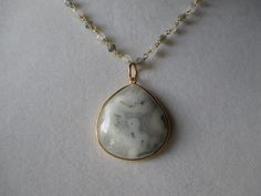 Solar quartz is stunning and this piece loos incredible on a labradorite chain.