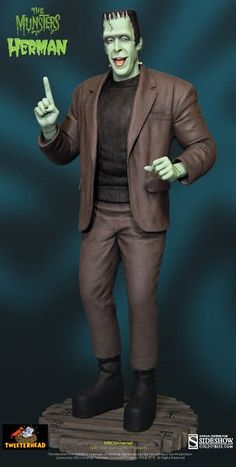 Herman Munster Polystone Statue from The Munsters, Tweeterhead 902168 Herman Munster Polystone Statue from The Munsters. It is made by Tweeterhead and is approximately 38 cm (15.0 in) high Sideshow Collectibles is proud to introduce the first release in Tweeterhead's full ine of The Munsters Maquettes!  Herman Munster stands at an impressive 15 inches tall and will soon be followed by the rest of the family, including, Lily, Grandpa, Eddie and Marilyn and for the first time ever Cousin…
