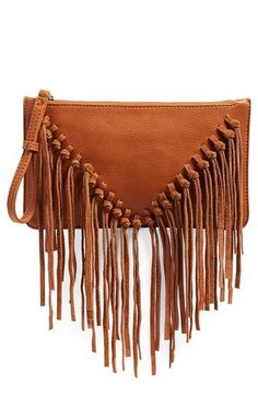 shipping and returns on Sole Society Suede Fringe Clutch at . A knotted swath of suede fringe lends stylish movement to a bohemian clutch that transitions seamlessly from the workweek to weekend festivals. Leather Handle, Leather Purses, Leather Handbags, Leather Bag, Leather Totes, Women's Handbags, Leather Fringe, Real Leather, Brown Leather