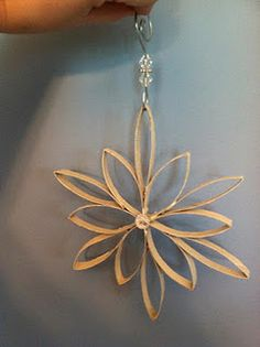 DIY toilet paper roll Star/Snowflake Christmas Ornament. add spray paint and/or glitter, small beads, etc.