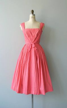 Vintage 1950s Suzy Perette bright watermelon cotton dress with square neckline, wide shoulder straps, wide pleated bodice with one large inverted pleat, fitted waist, very full skirt and metal back zipper. --- M E A S U R E M E N T S ---  fits like: medium bust: 39 waist: 28 hip: free length: 46 brand/maker: Suzy Perette condition: excellent  to ensure a good fit, please read the sizing guide: http://www.etsy.com/shop/DearGolden/policy  ✩ layaway is available for...