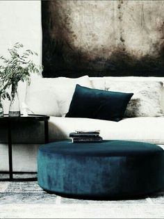 #interior design #living room #round ottoman Petrol blue