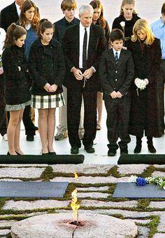 Caroline Kennedy Schlossberg with husband Ed, Rose, Tatiana and John at JFK and Jackie's graves. Arlington National Cemetery, Washington D.C.