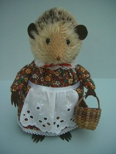 This sweet little hedgehog is tall and has a mohair head, black bead eyes, ultrasuede ears and paws and a hand embroidered nose. Her body is made from wool felt and her pretty dress is cotton with a br. Bear Design, Applique Designs, Larp, Wicker Baskets, Pretty Dresses, Wool Felt, Kids Toys, Hedgehog, Doll Clothes