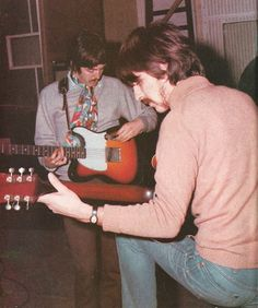 Paul & George work out guitar parts for the title track. Sgt Pepper, 1967