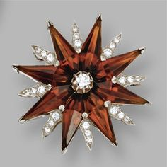 Citrine and diamond starburst brooch