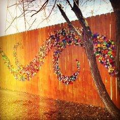 Using bottle caps as art. Love the idea for a blank wall or fence!