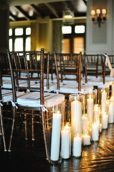 Pillar Candles in Aisle | photography by http://rebekahwestover.com/ | event design by http://www.michelleleoevents.com/
