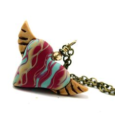 Heart with wings pendant by River Wolfe