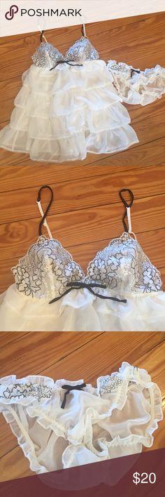 NWOT Victoria's Secret Babydoll lingerie NWOT white ruffled Babydoll Lingerie. Comes with panties. Victoria's Secret Intimates & Sleepwear Chemises & Slips