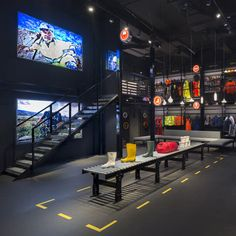 Hard hats and high visibility jackets are displayed as fashion items at this Singapore boutique that architects Ministry of Design designed for a safety equipment brand.