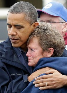 It wasn't just a hug, he HELD her in his arms.. I saw him sway back and forth while holding her and I actually rewound the DVR because I was so inspired by his honest expression of compassion and sympathy. The President of the United States of America rocked this woman in his arms in the same way I would comfort a friend in sorrow. I am so THANKFUL he is our President during this National Crisis.