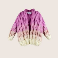 This lovely three tone cardigan is made with the signature large stitches of Nino and Lalo Dolidze and effortlessly transits itself from deep pink to light pink and then cream. #FancyKids #London #Fashion #Kids #Eco #Cotton #Natural #Children #Mayfair #Colour