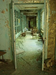 Hall in an abandoned building in the ghost town of Chernobyl.  Photo by Julia Dimon Travel Junkie on Flickr.