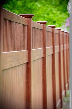 Grand Illusions Color Spectrum Rosewood Tongue and Groove Privacy fencing panels with Classic Victorian Framed Top Pickets from Illusions Vinyl Fence. Wood Vinyl, Pvc Vinyl, Painted Wood Fence, Privacy Fence Panels, Yard Privacy, Vinyl Railing, Victorian Frame, Victorian Decor, Fencing Material