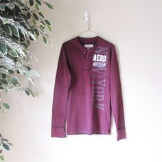 Sweatshirt Top by AEROPOSTALE Lazy Sundays call for cozy sweatshirts. Get your hands on this nice burgundy colored one by Aeropostale. Features a button up front Henley style and the Aeropostale logo. This shirt was from the male section, therefore it fits XS for guys and S for girls. Nice thick fabric. 100% cotton. Flaw includes a small hole on the bottom right side. Aeropostale Tops Sweatshirts & Hoodies