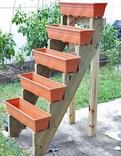 A tiered planter stand using stair runners. I have some from a deck I dismantled that would be perfect for this!