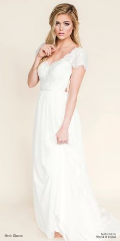 This free-spirited dress features a modified v-neck/sweetheart bodice, delicate cap sleeves and a simple grosgrain ribbon at the waist. The flowing chiffon skirt and ultra low-back is finished with beautiful lace appliqués that trickle down the chapel train.